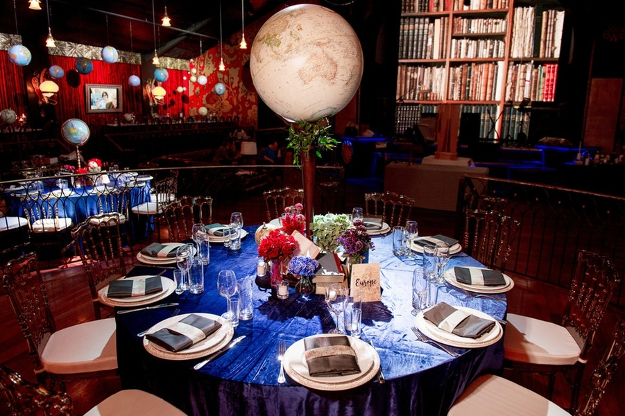 blue velvet table cloth with globe around the world centerpiece