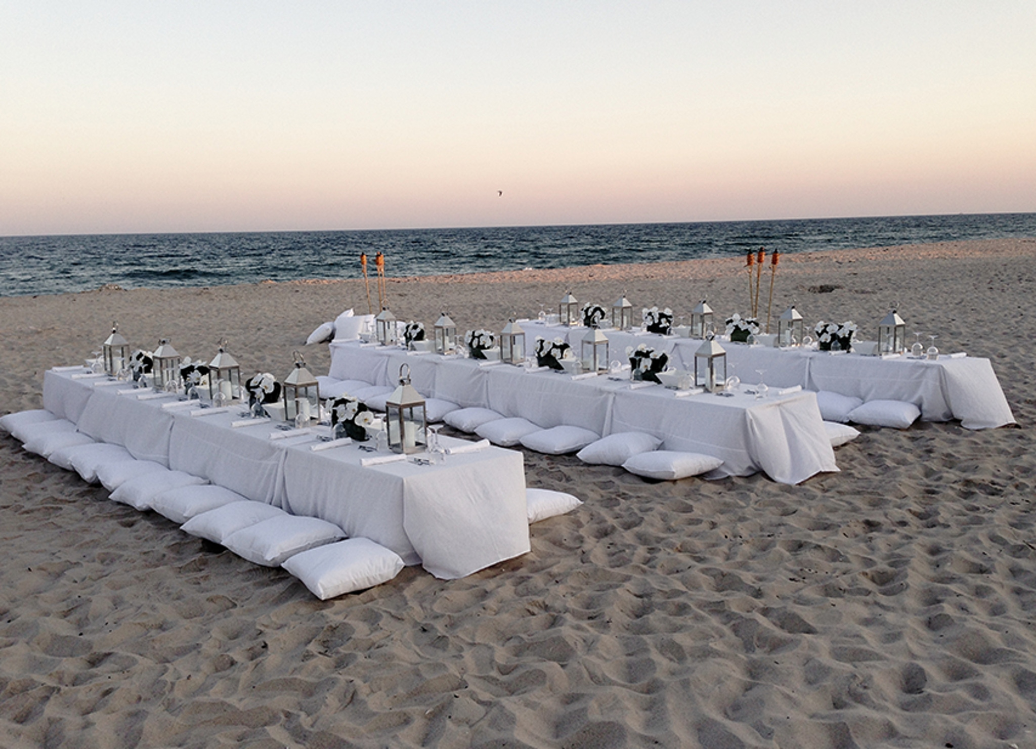 white beach reception on sand in hamptons