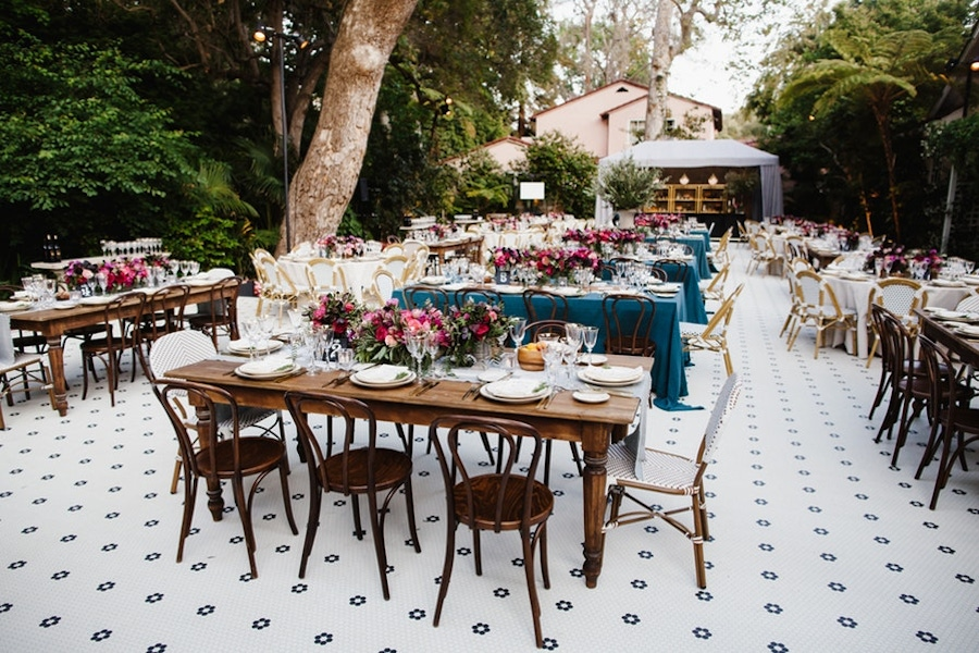 Wood chairs and table, tile floors, and colorful flowers
