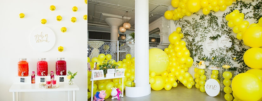Yellow balloon display and juice pitchers