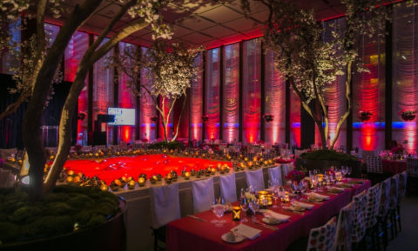 Red party decor with greenery accents