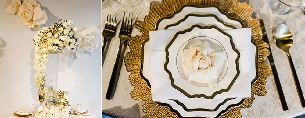 Gold detailed plate settings and white floral arrangement