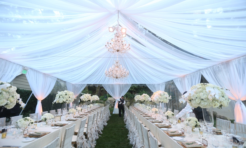 napa tented reception with white draping and chandeliers