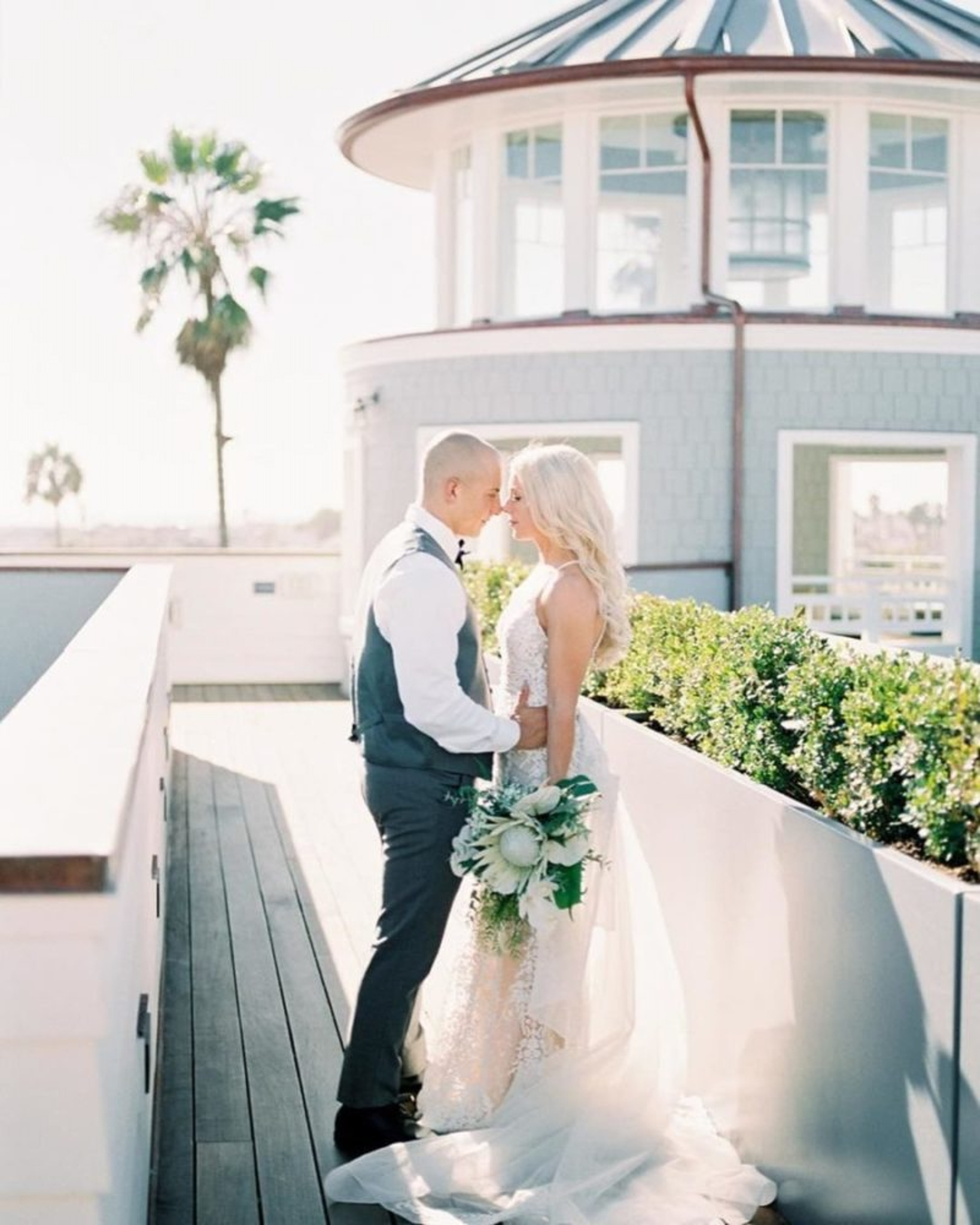 Couple in front of beach house at Lido House