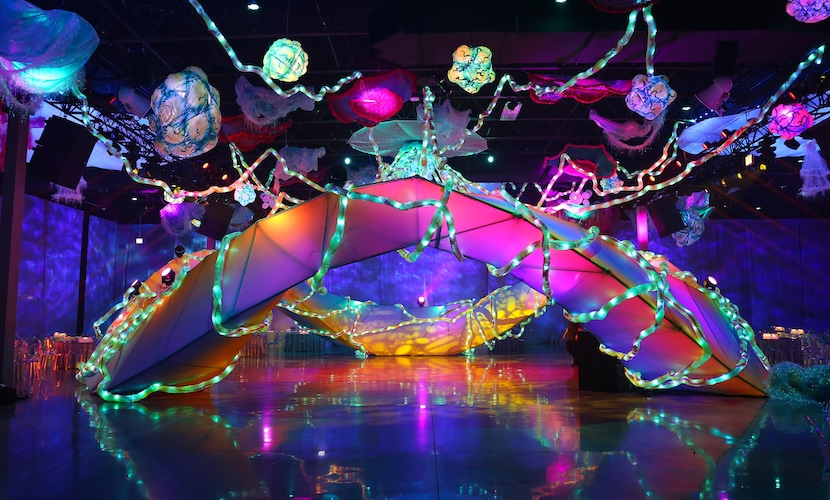 green, purple and blue lights and large dance floor