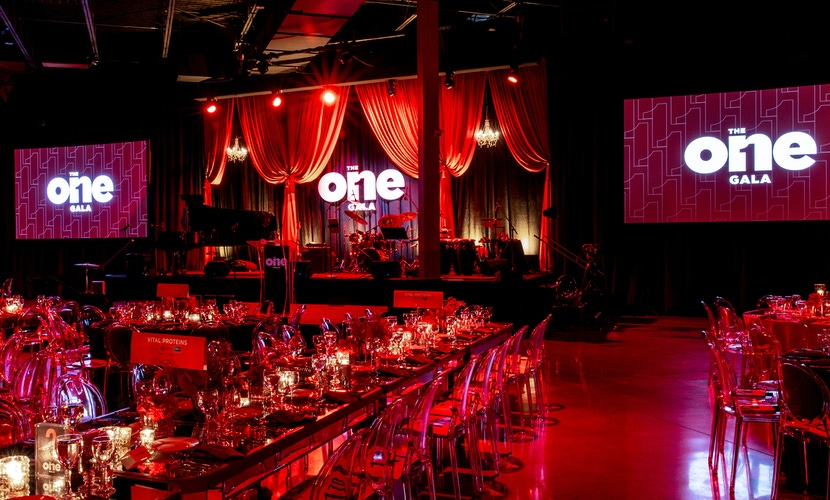 ghost chairs, red lighting and draping and big screens