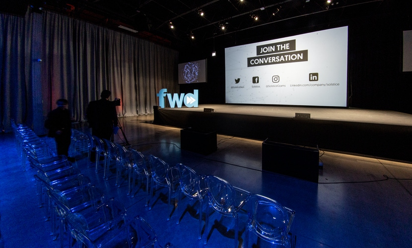 ghost chairs and blue lighting at fwd event
