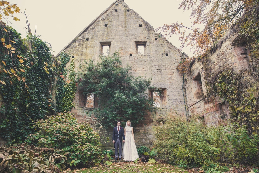 Couple in front of stone building
