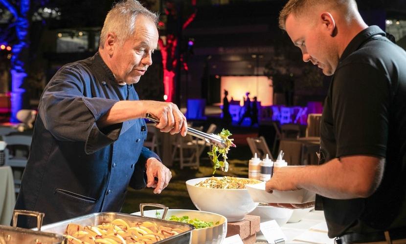 Man serving food at Wolfgang Puck