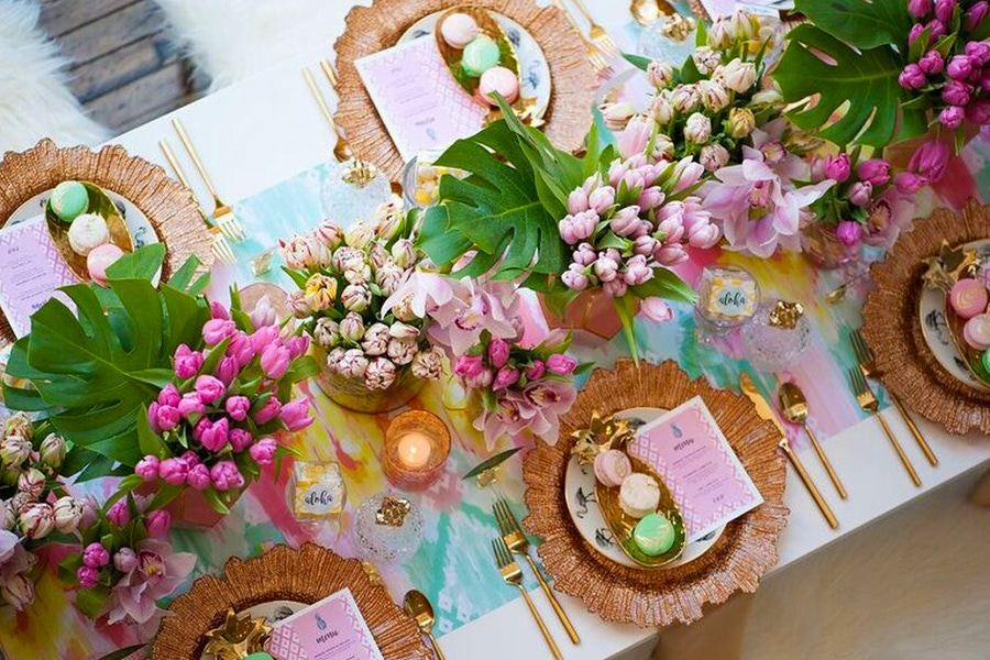Pink tulips with pastel place settings