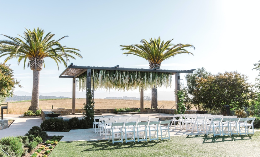 floral trellis and palm trees view in napa wedding ceremony