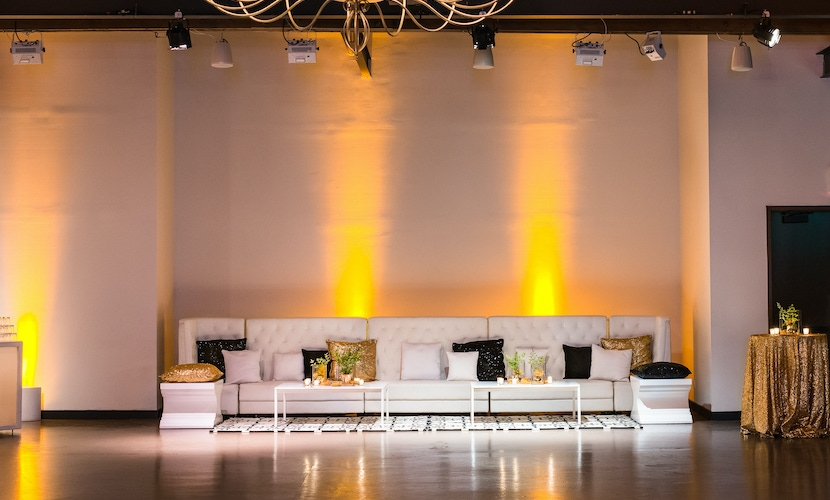 yellow lighting and white couches at PartySlate party
