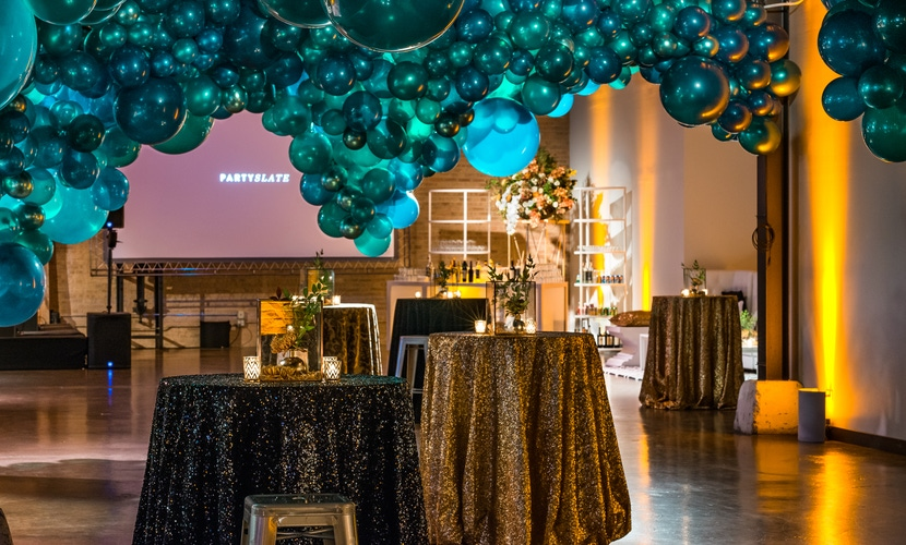 Blue balloons and gold tablecloth PartySlate Chicago