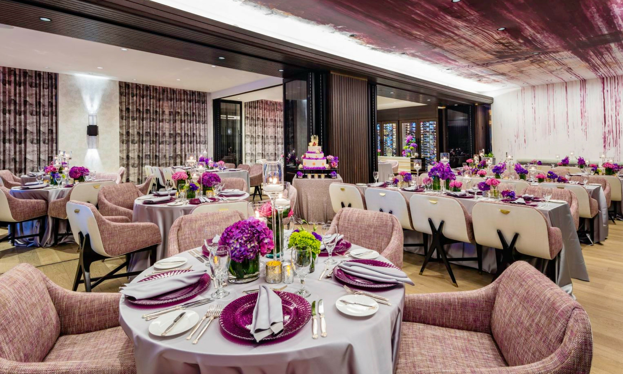 dramatic burgundy accented ceiling over dinner party at loews miami beach hotel