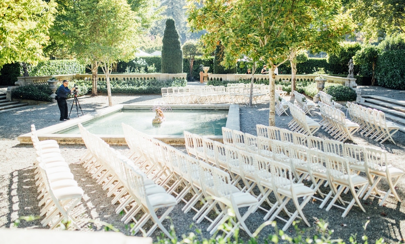 napa outdoor wedding ceremony in lush garden with water feature