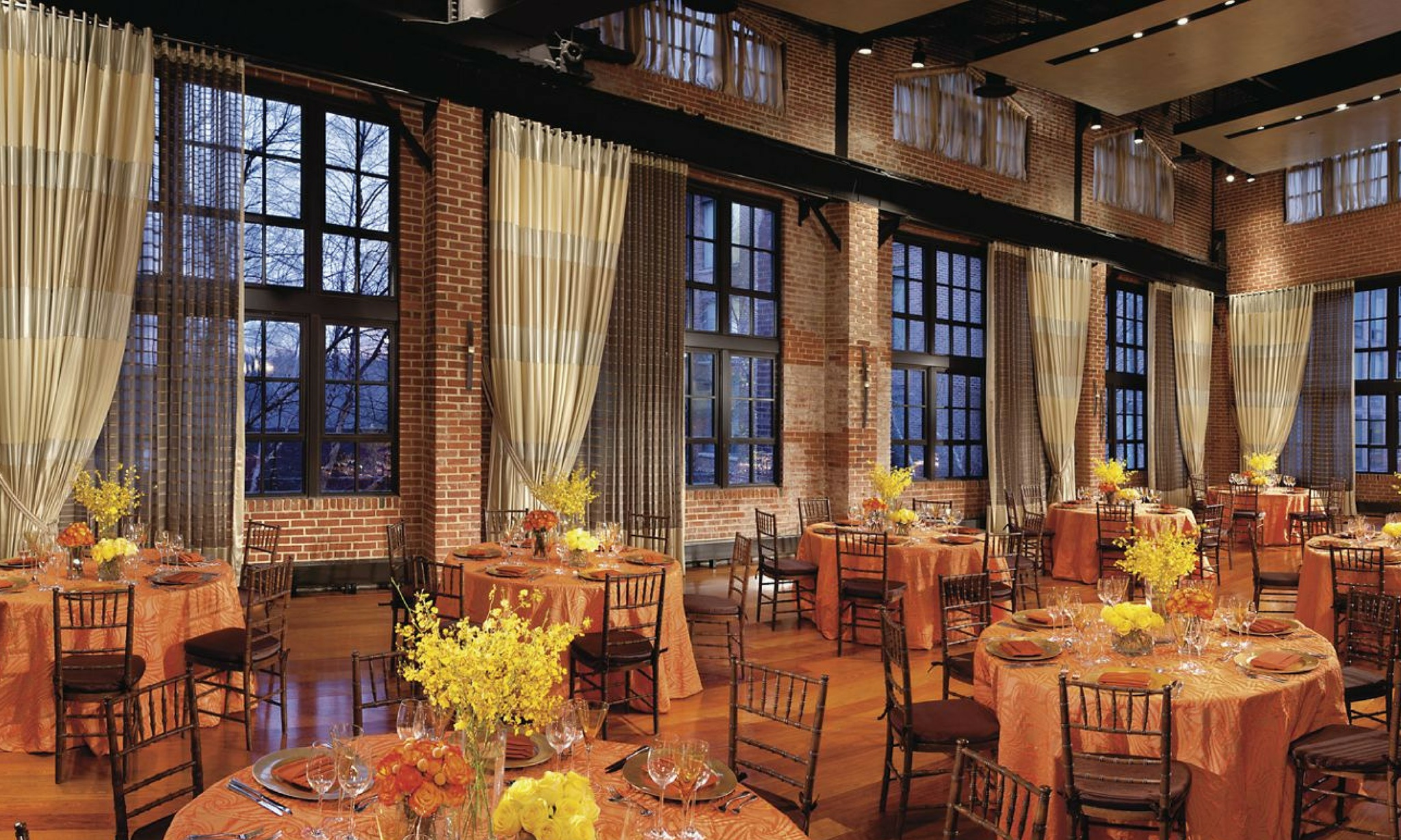 bright event space with tall windows and white drapery at ritz-carlton georgetown