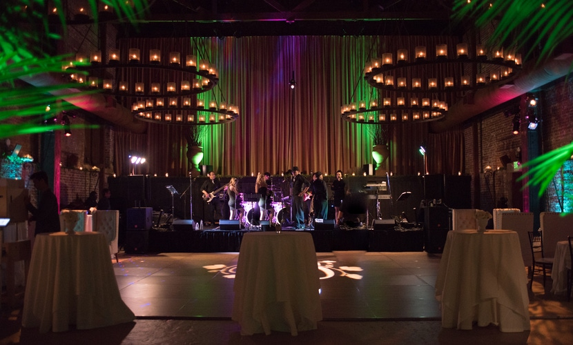 napa wedding reception with green and purple lighting