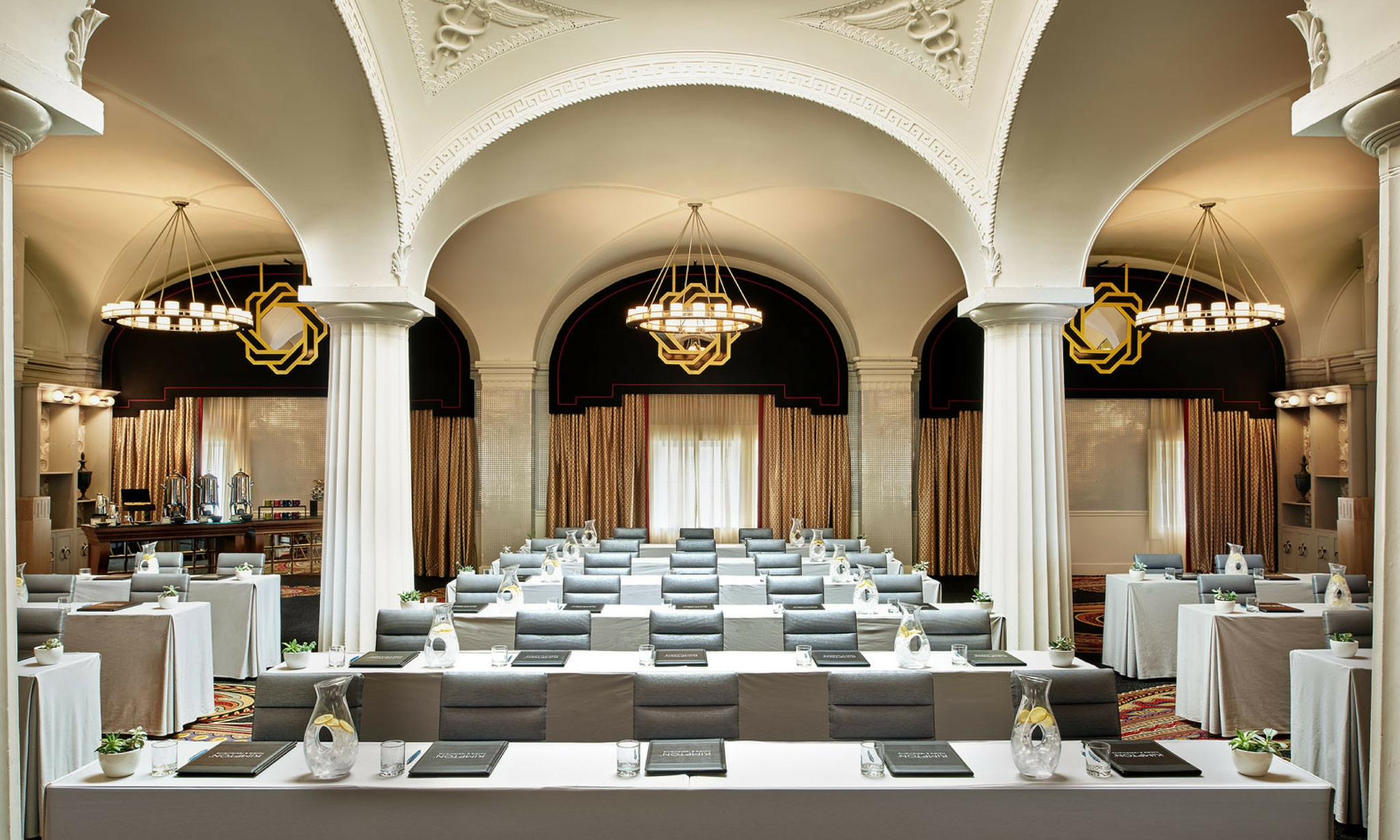 dramatic white arches over meeting at hotel monaco in washington d.c.