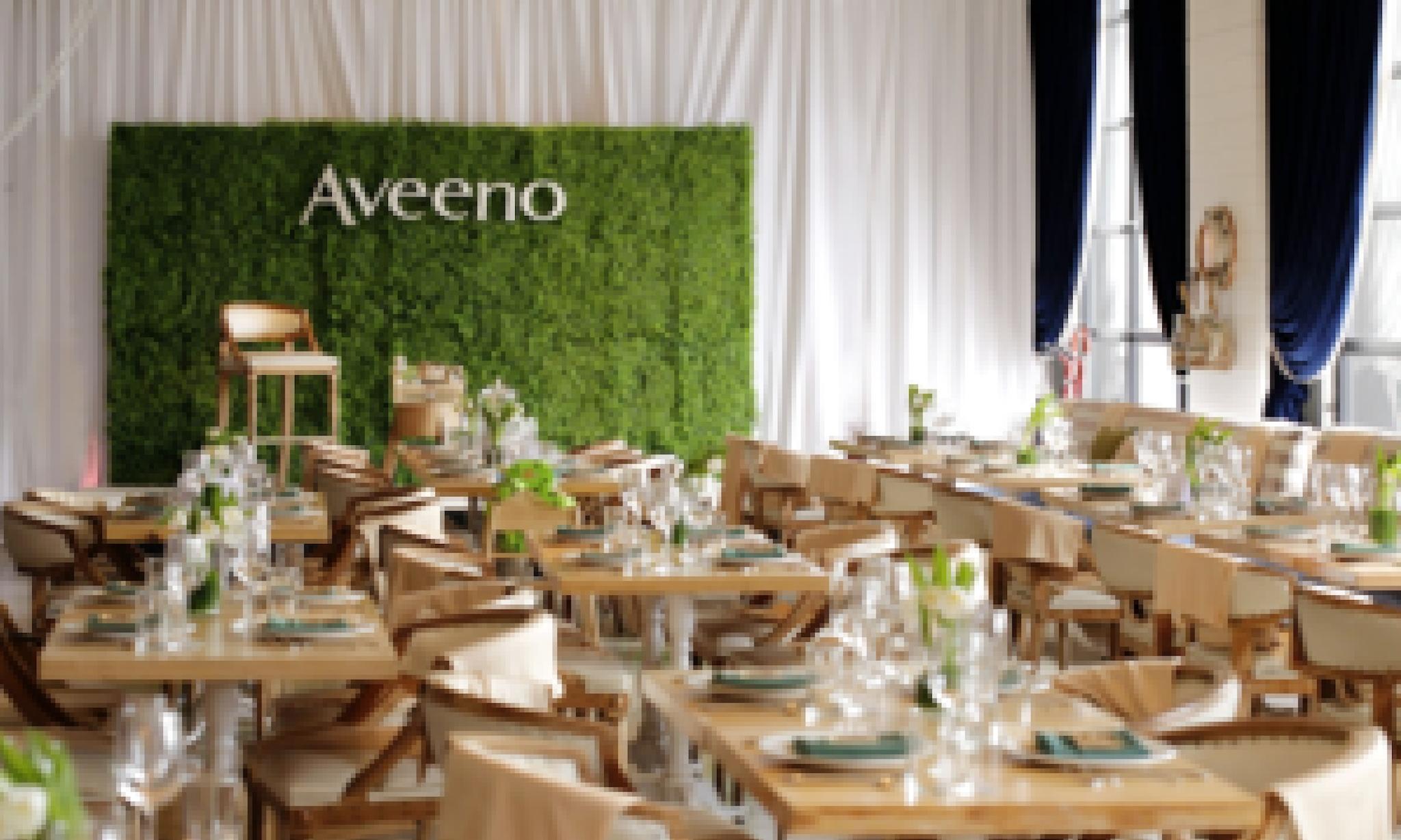 Aveeno sign on ivy wall