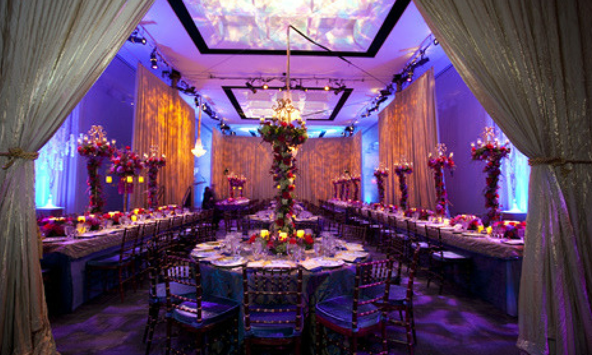 white draped entrance leads into violet-uplit event space at landmark the kennedy center in washington, d.c.
