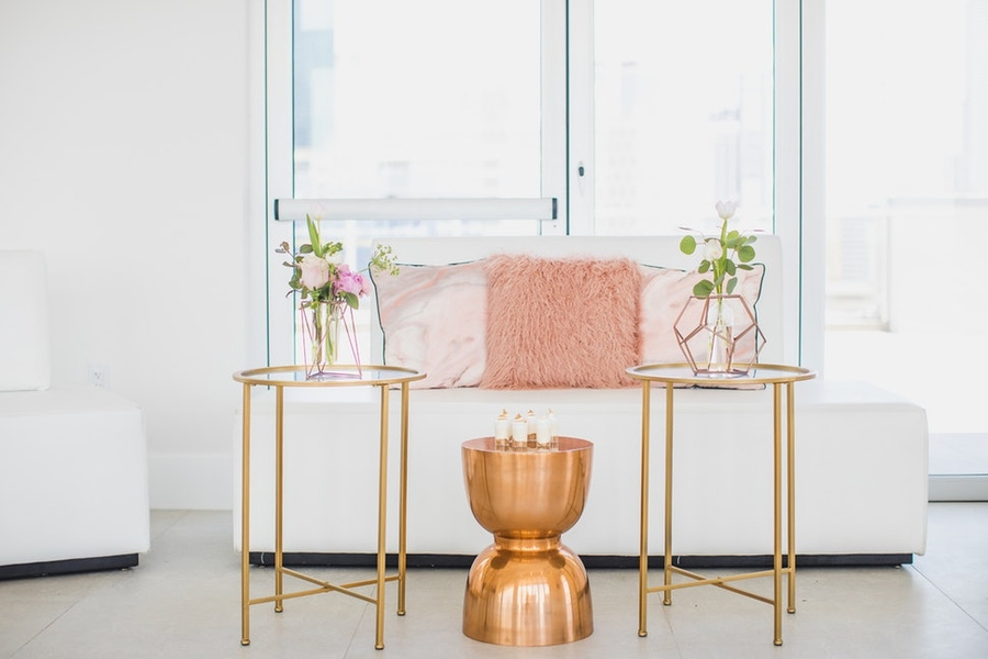 gold tables and pink pillows