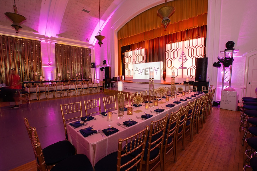 Venue with gold accents and pink lighting