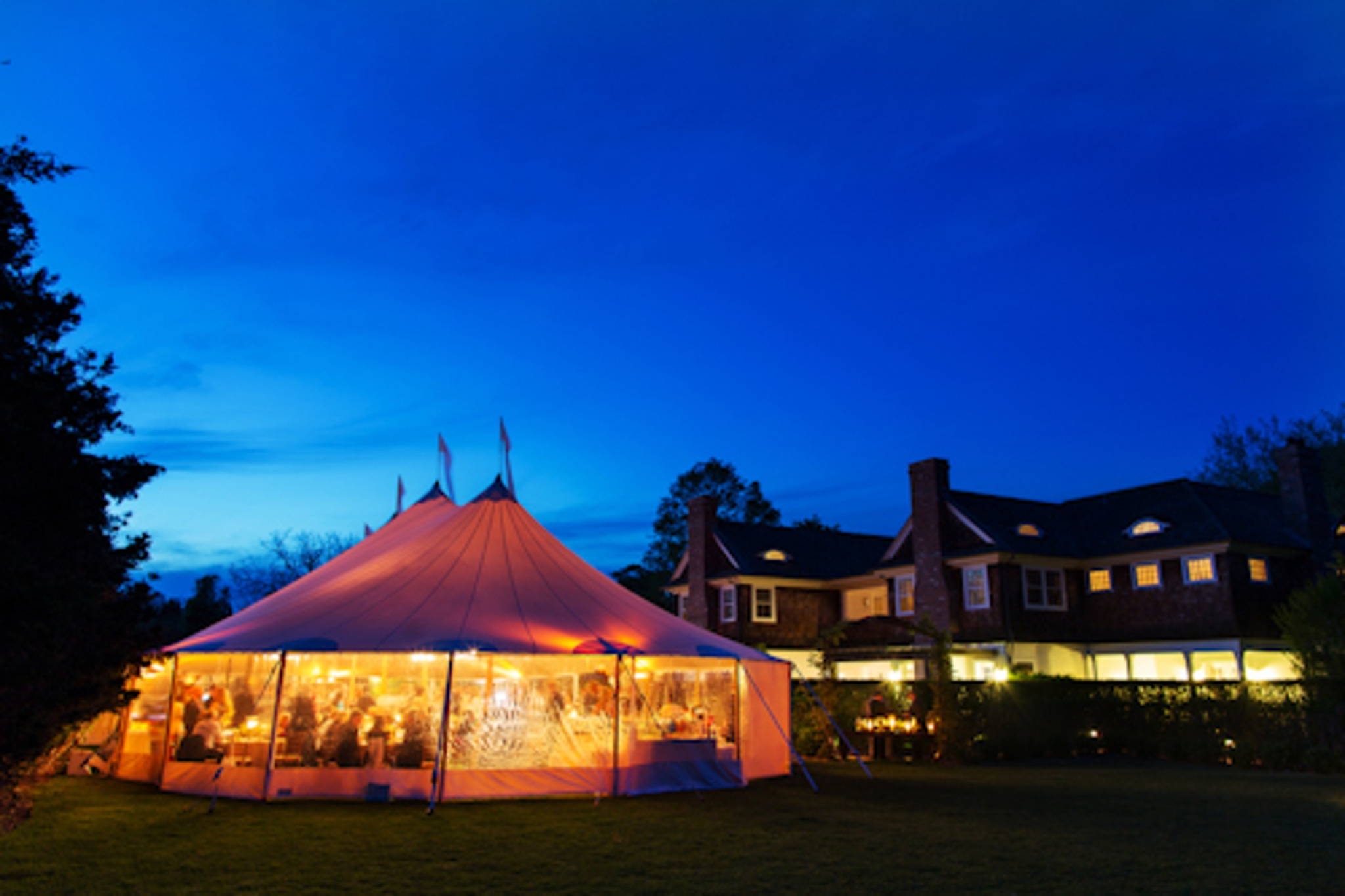 glowing tented evening reception in hamptons