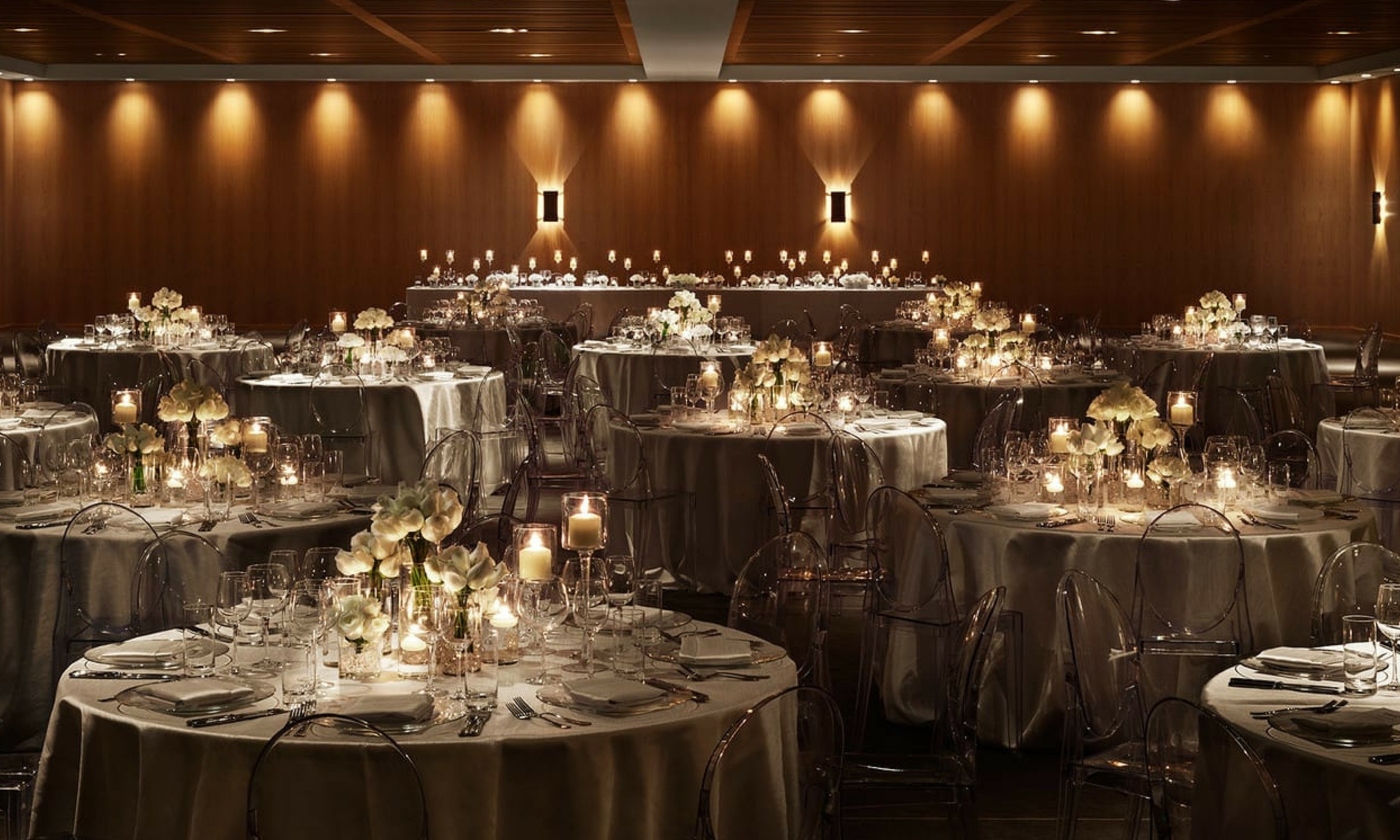 ballroom bathed in golden light and decorated in neutral tones at the miami beach edition