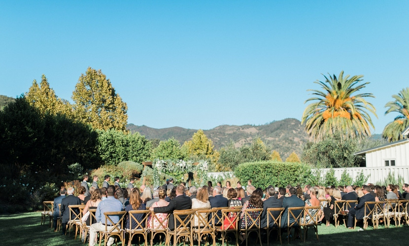 napa valley outdoor wedding ceremony with mountain and trees view