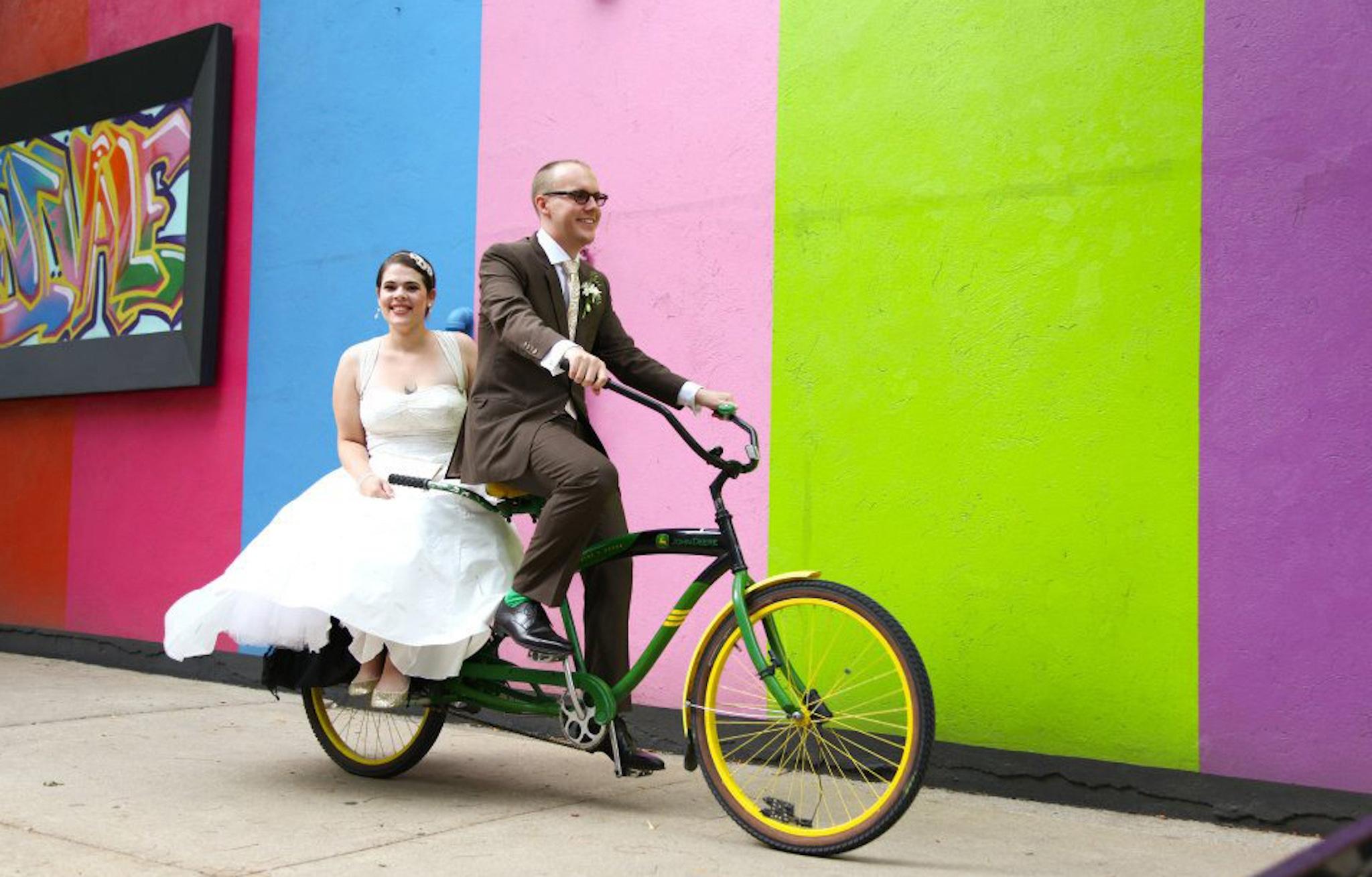 Bride and groom on bike
