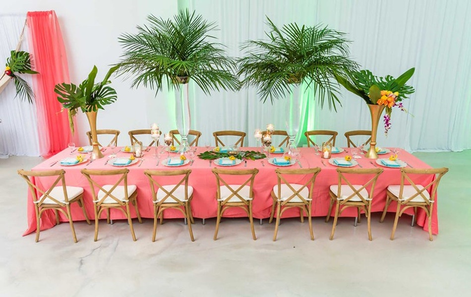 pink table and palm trees