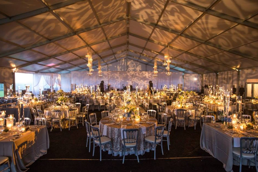 Tented event space with candle lit lighting
