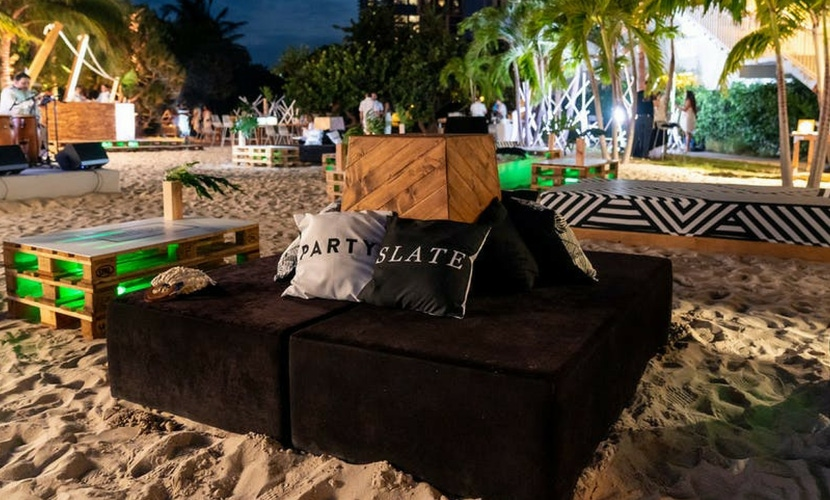 PartySlate pillows on beach