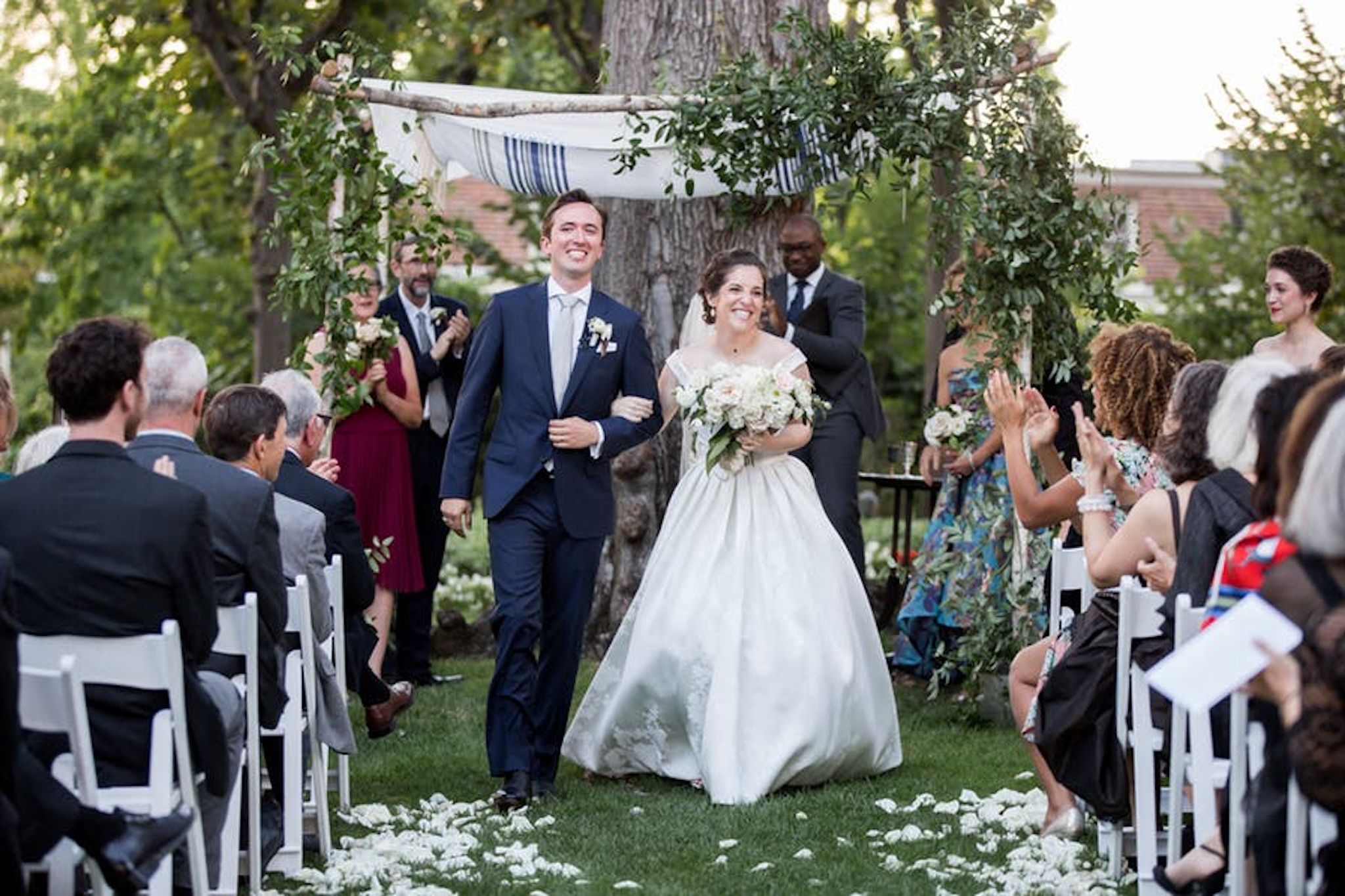 garden wedding ceremony featuring chuppah and trees at meridian house in washington, d.c.