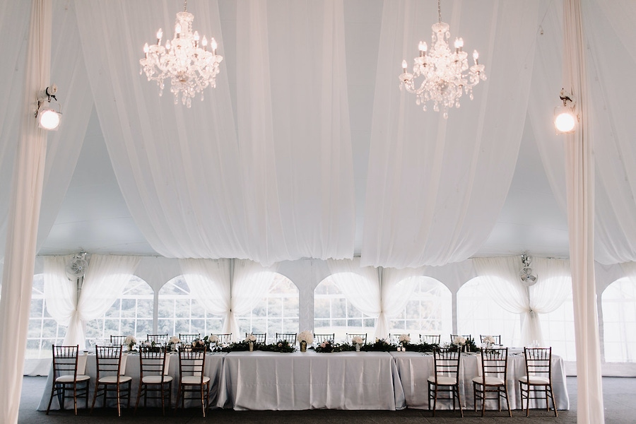 White tent with hanging chandeliers at The Morton Aboretum