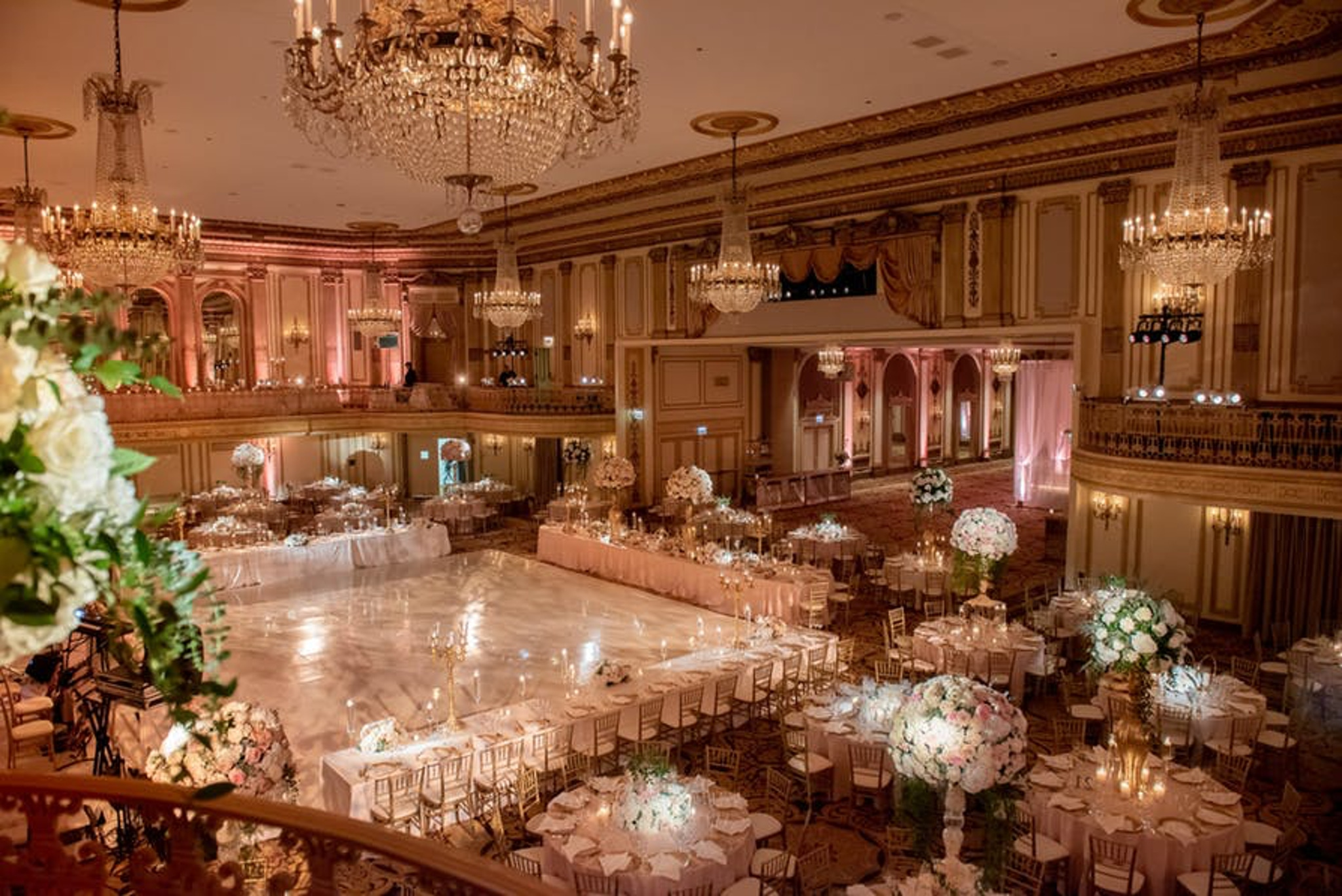 a massive ballroom with warm lighting