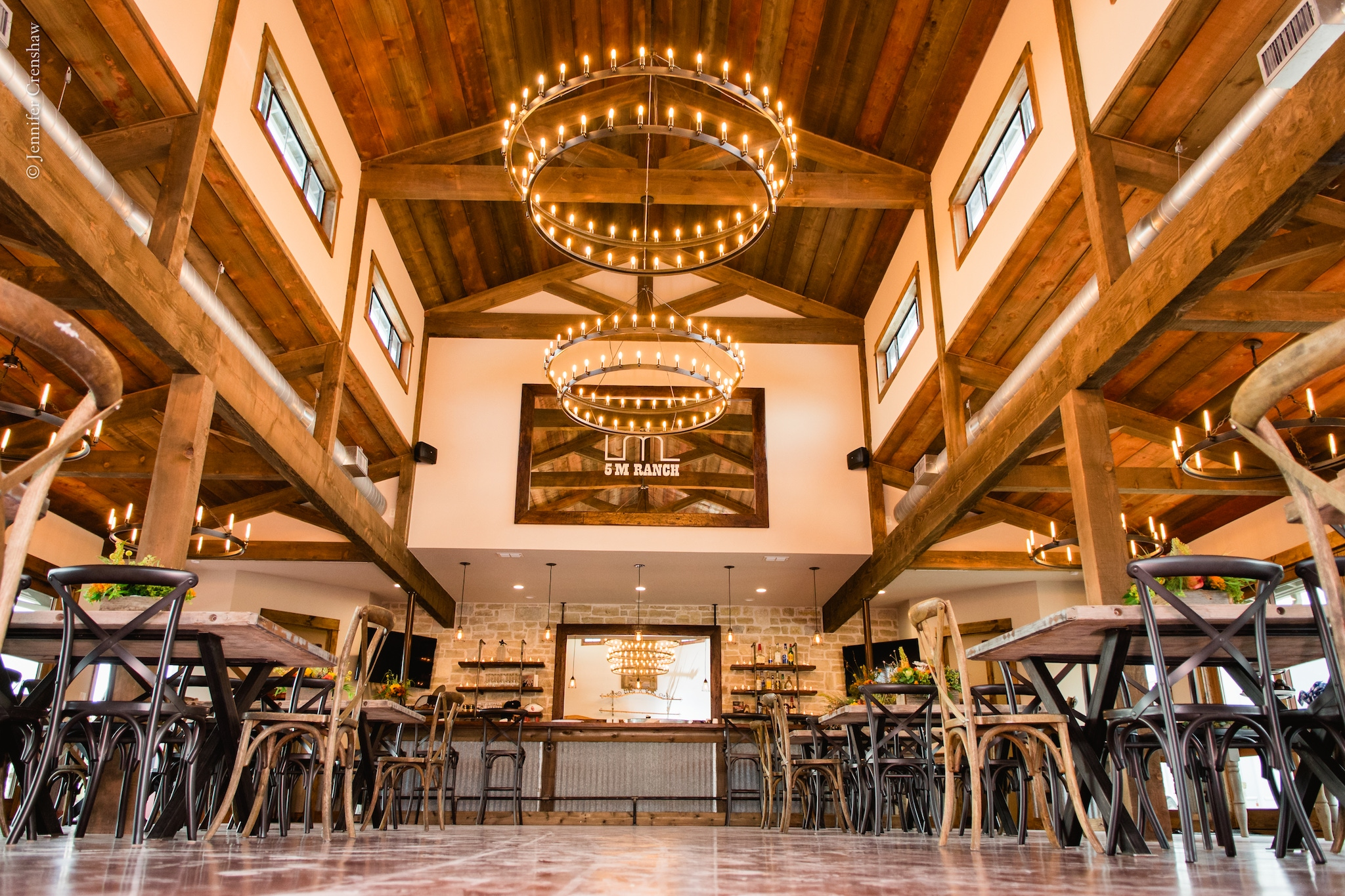 Texas ranch with rustic theme and hanging chandeliers