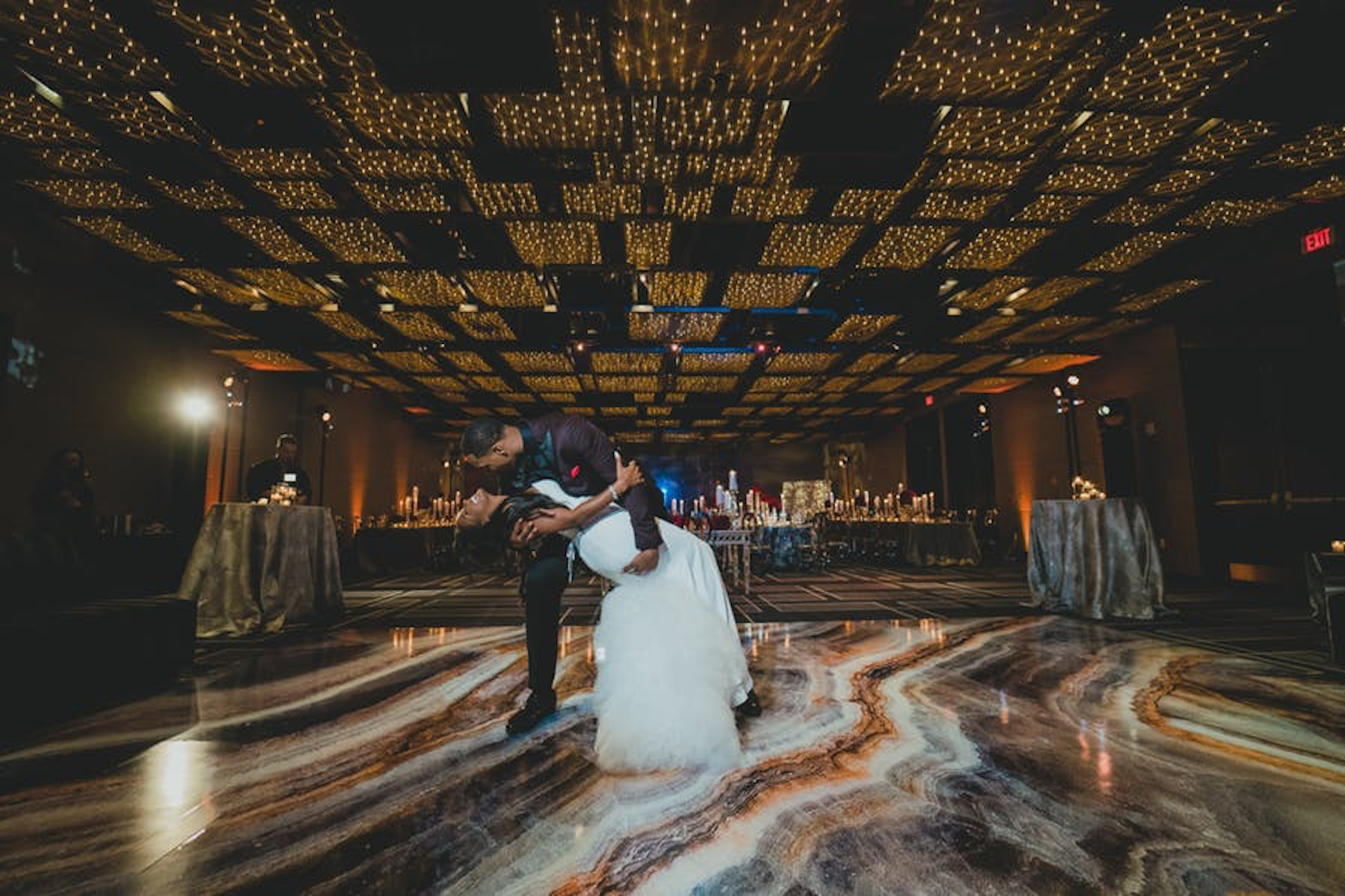 Couple dancing under twinkly lights