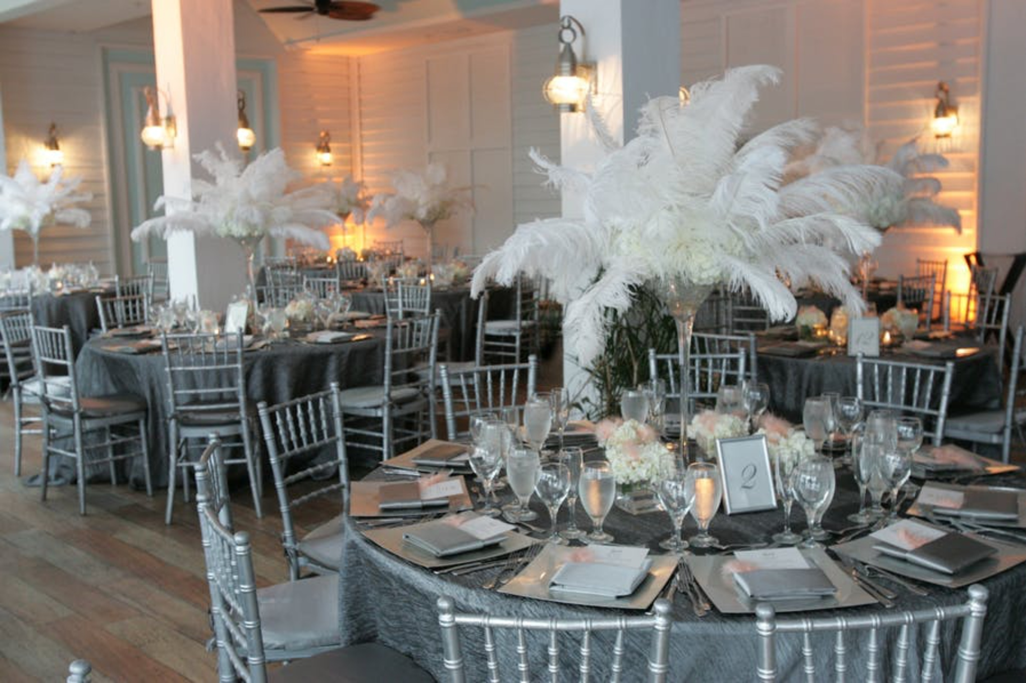 white feathers as centerpieces for art deco wedding in miami beach the palms hotel and spa