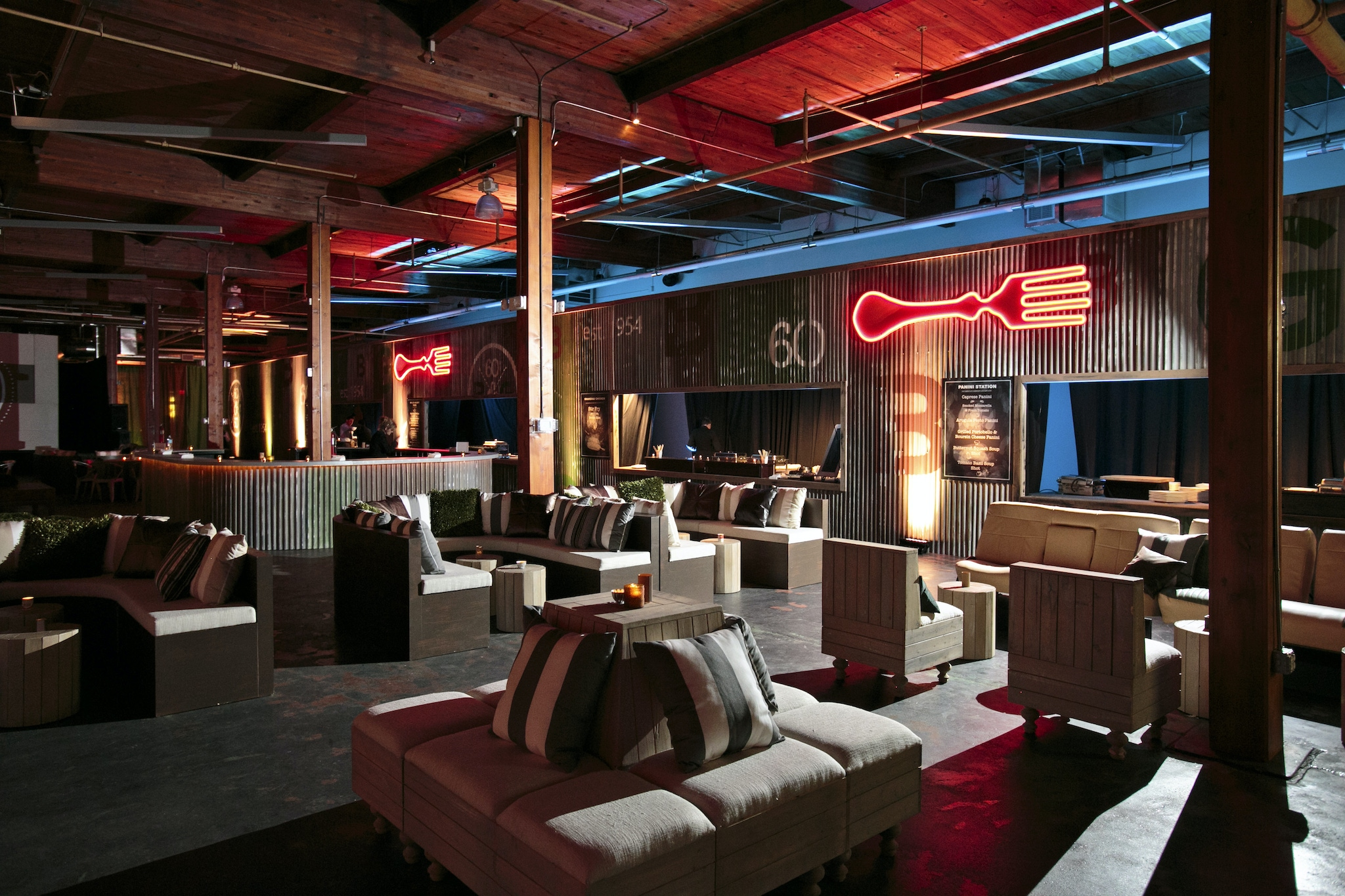Rustic event space with neon lit decorations in Dallas