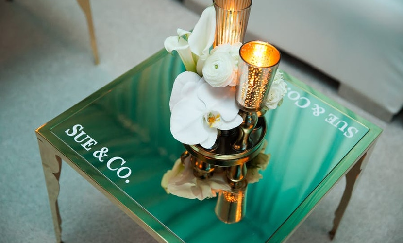 Gold candles with white flowers