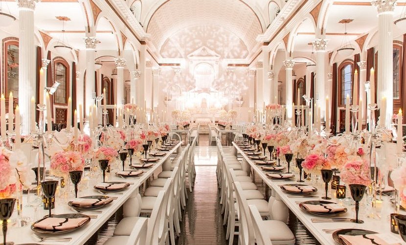 White dining room with pink floral decorations