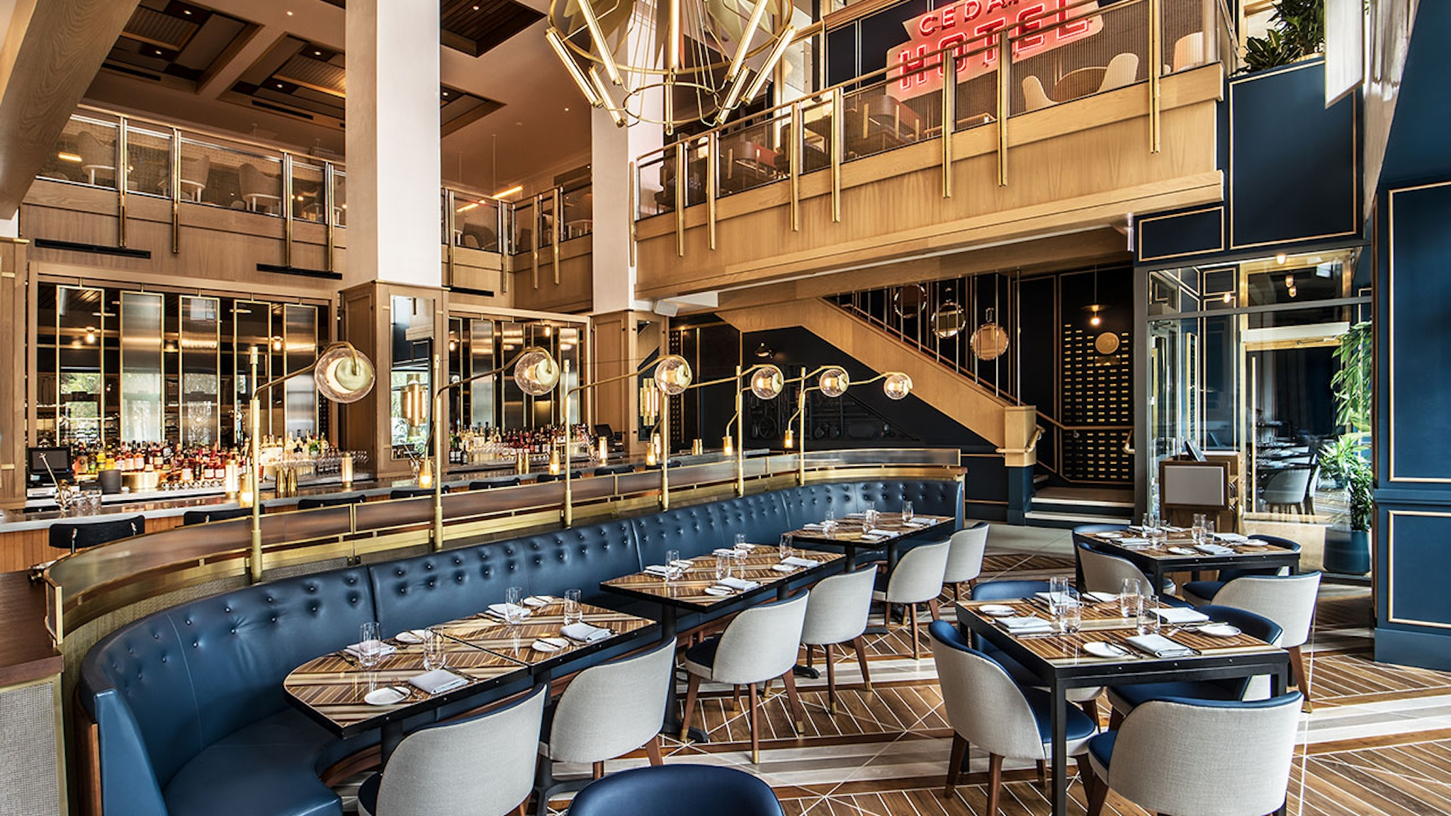 Blue dining booths and floor to ceiling windows at Viceroy Chicago