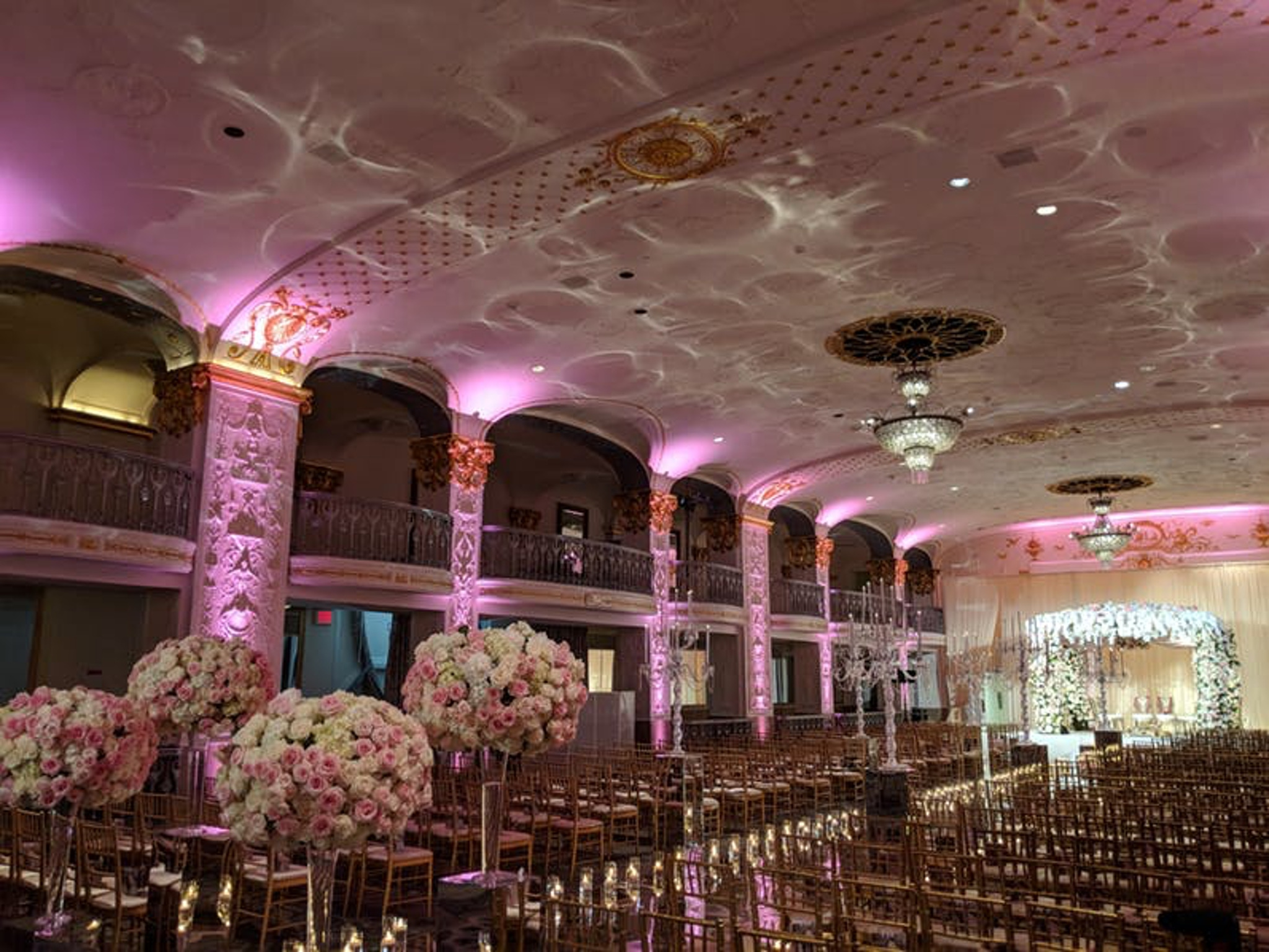 architectural detail on pink lit columns in ballroom at the mayflower hotel