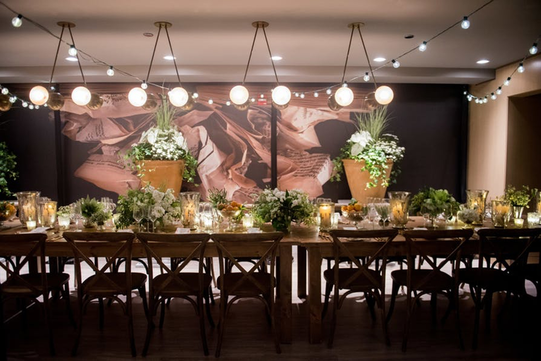a long table with greenery placed on top
