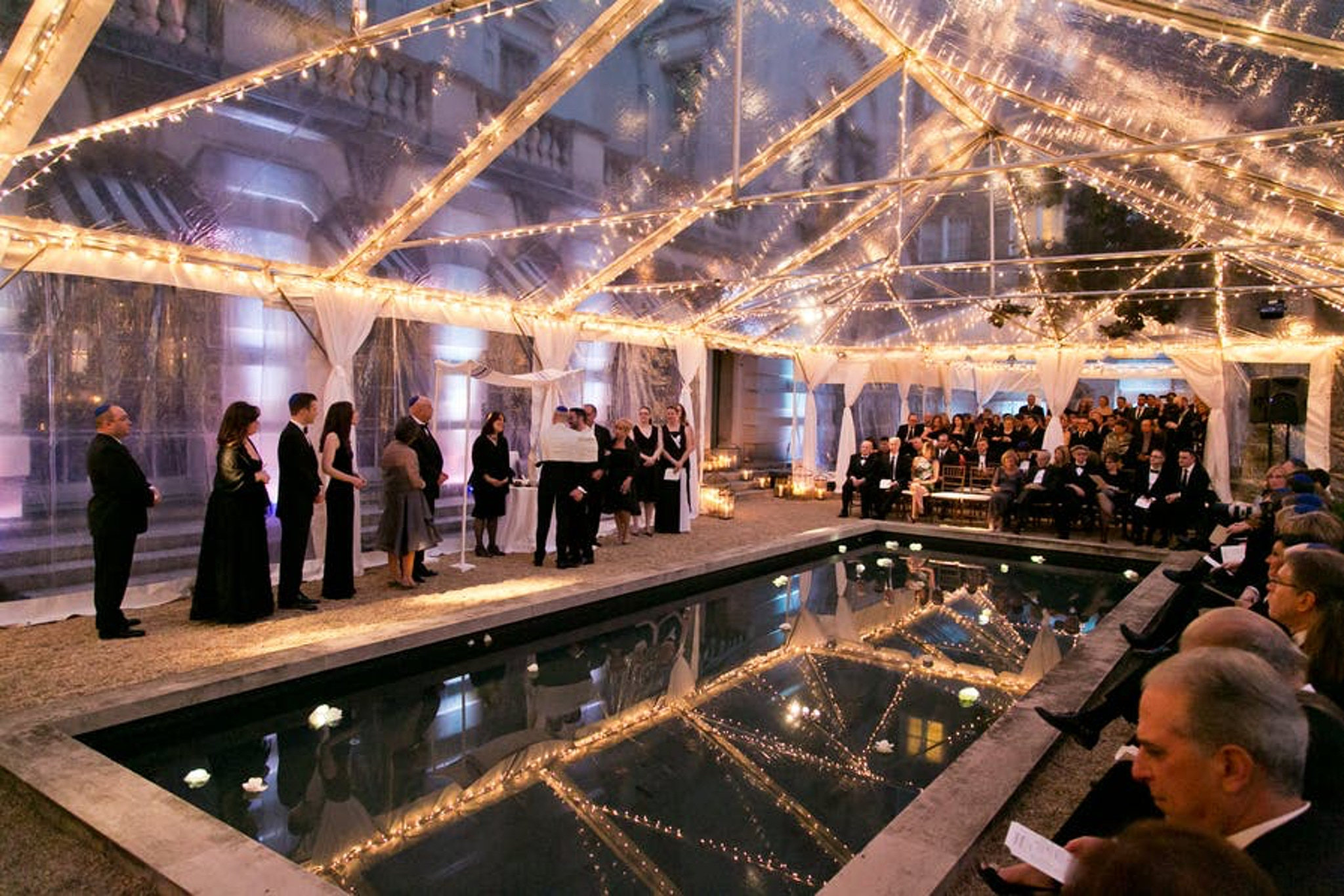 a clear tent covers the beautiful nighttime fountain at the society of cincinnati in washington, d.c.