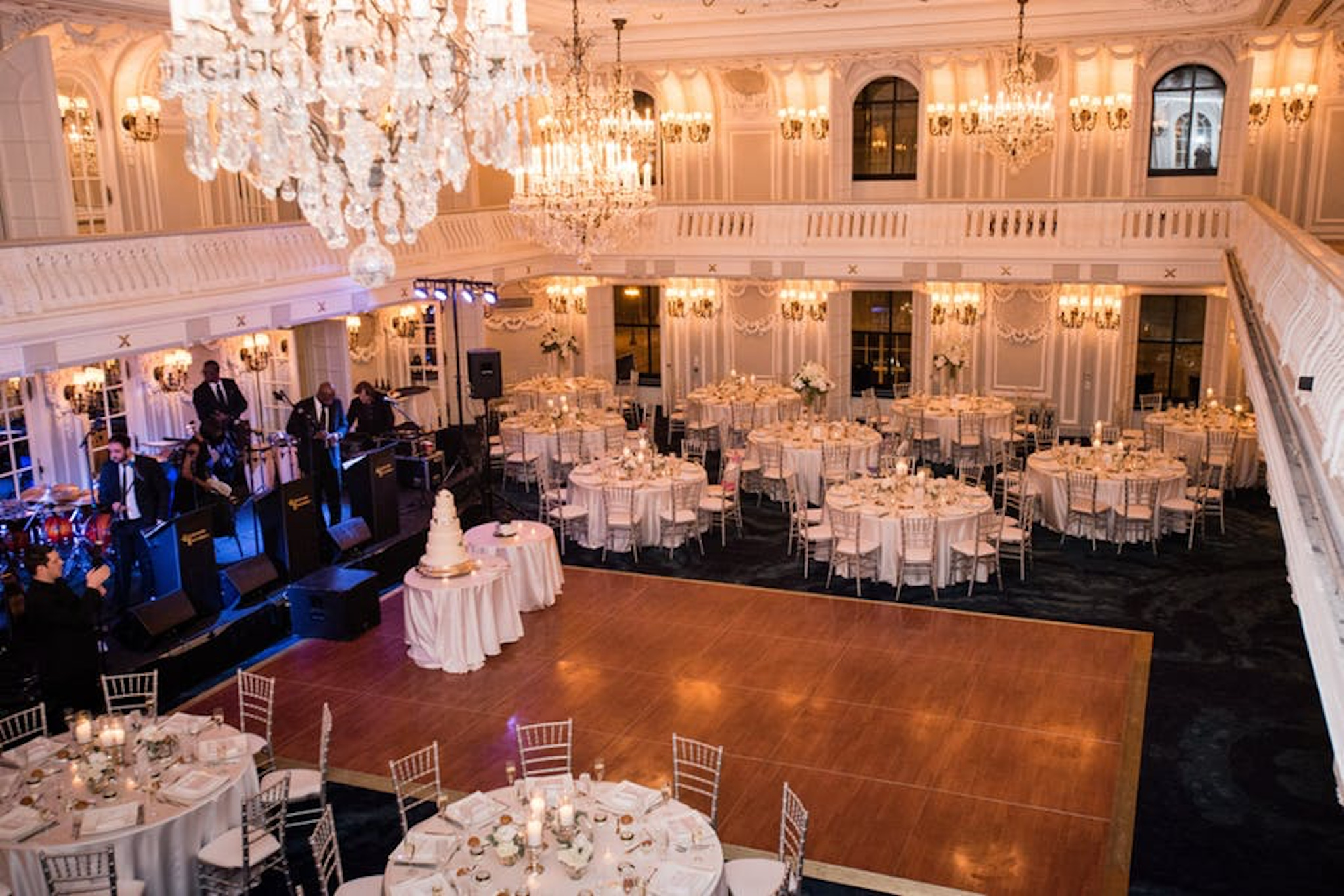 a view from above captures white linen tables and a dance floor