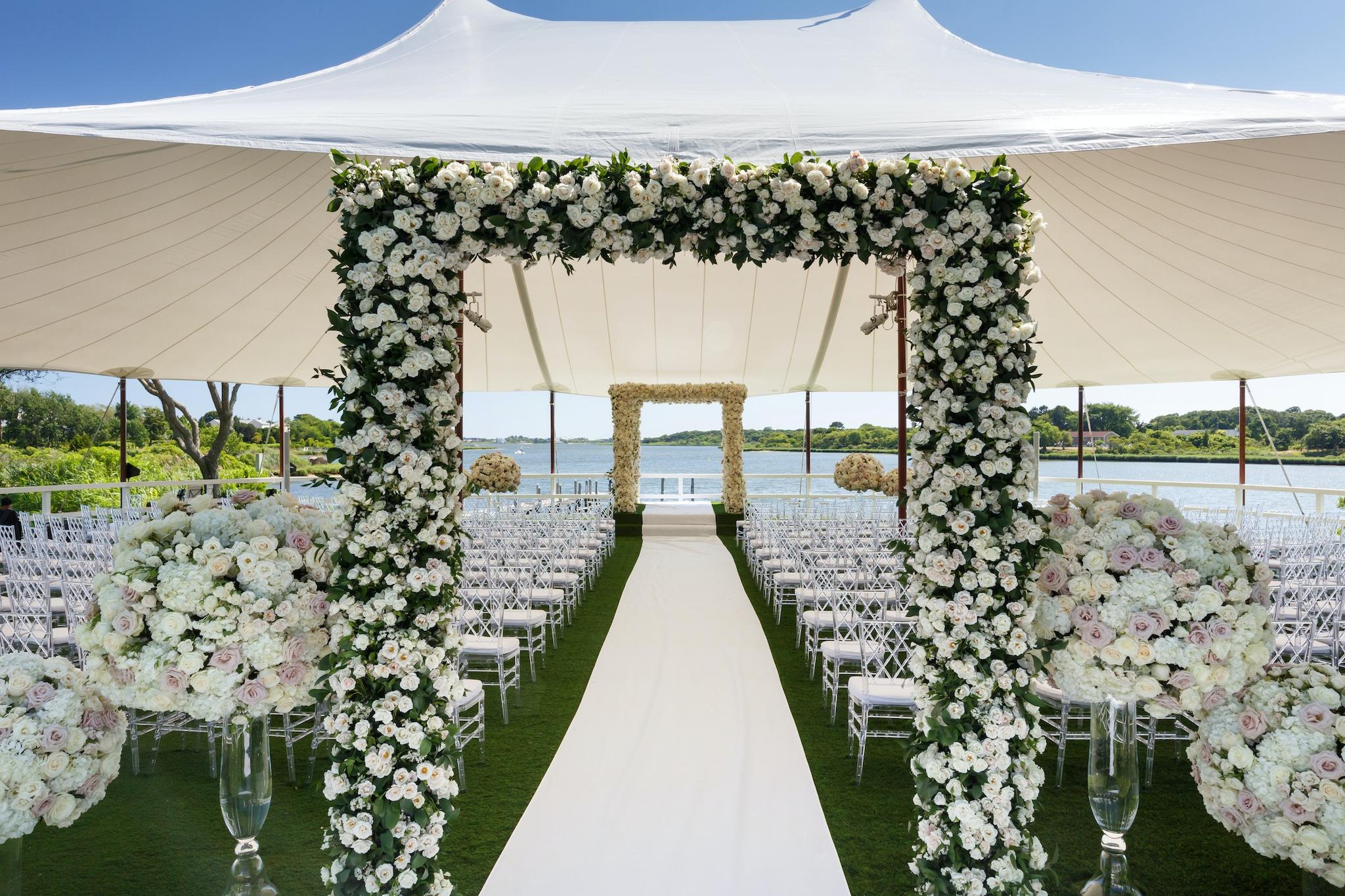 tented outdoor green wedding aisle