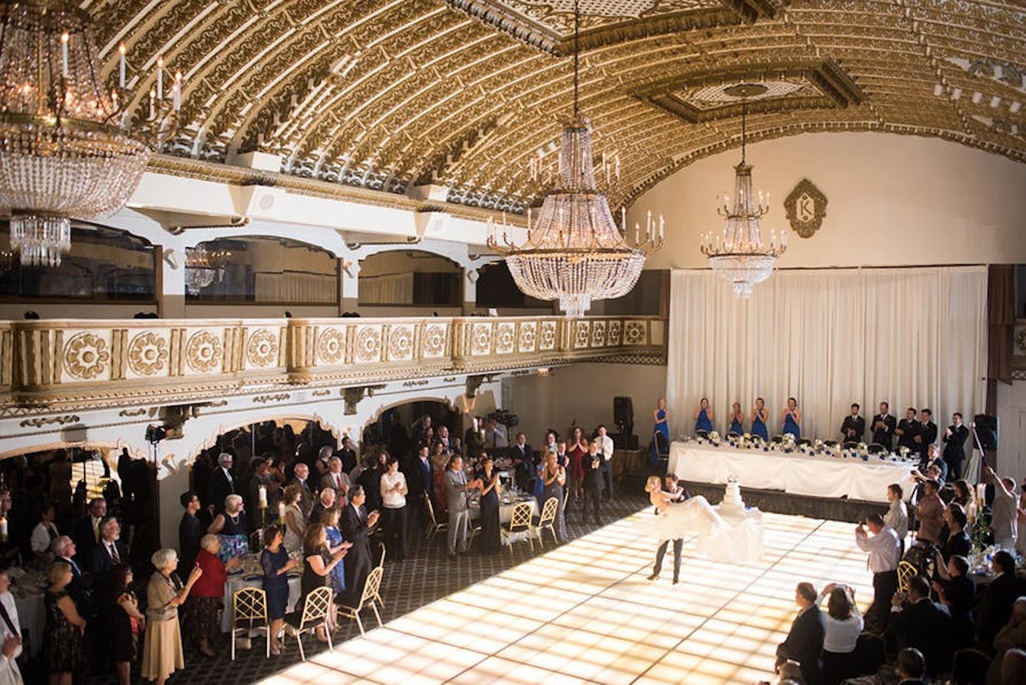 an expansive ballroom overlooks a wedding