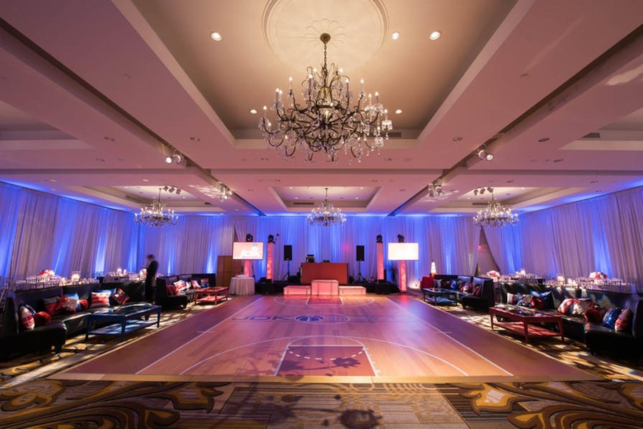 four seasons hotel ballroom dance floor with purple lighting and drapery